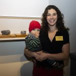 Anna Williams with her son and her work