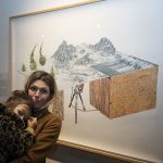 Artist Mélanie Myers with her work and son